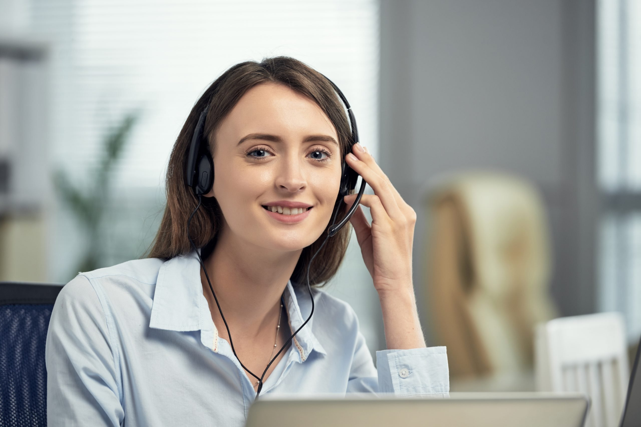 Telecoms for business - person smiling with headset on